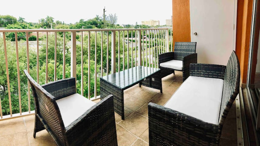 Spacious balcony with the nature view furnished with modern and elegant Lounge Furniture.