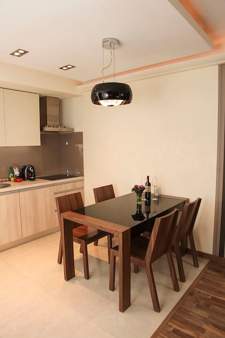 kitchen with induction hob and dishwasher, oven, microwave, kettle, toaster, refrigerator, coffee maker