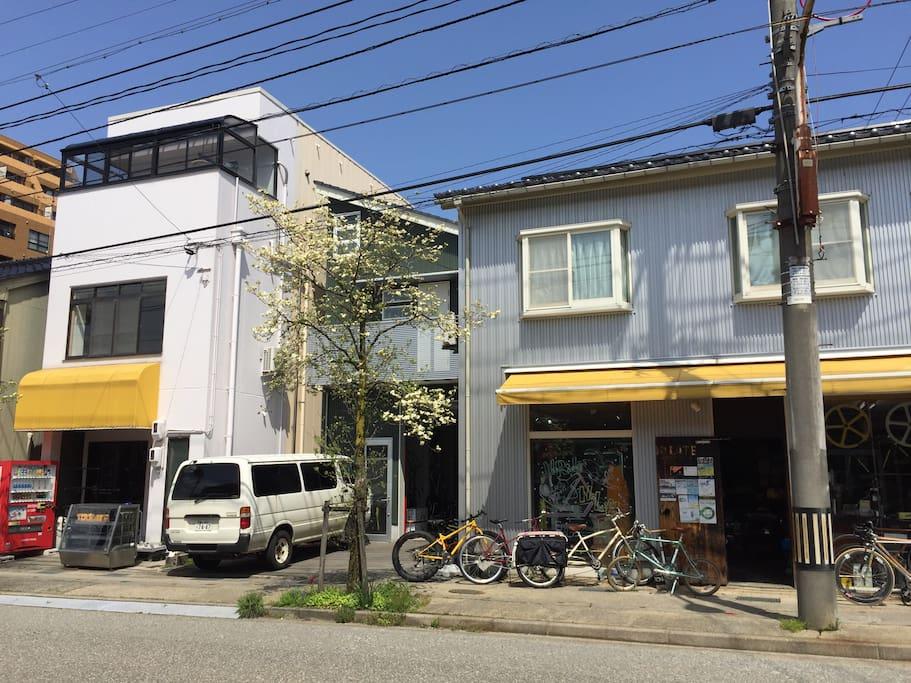 L to R  Guesthouse, garage,car space,shop