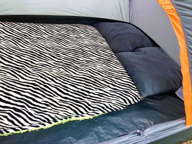 Floor mattress and pillows are provided with the tent.