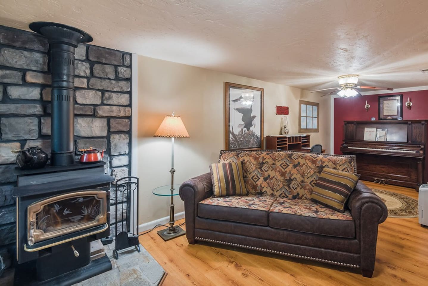 Living room area and wood stove.