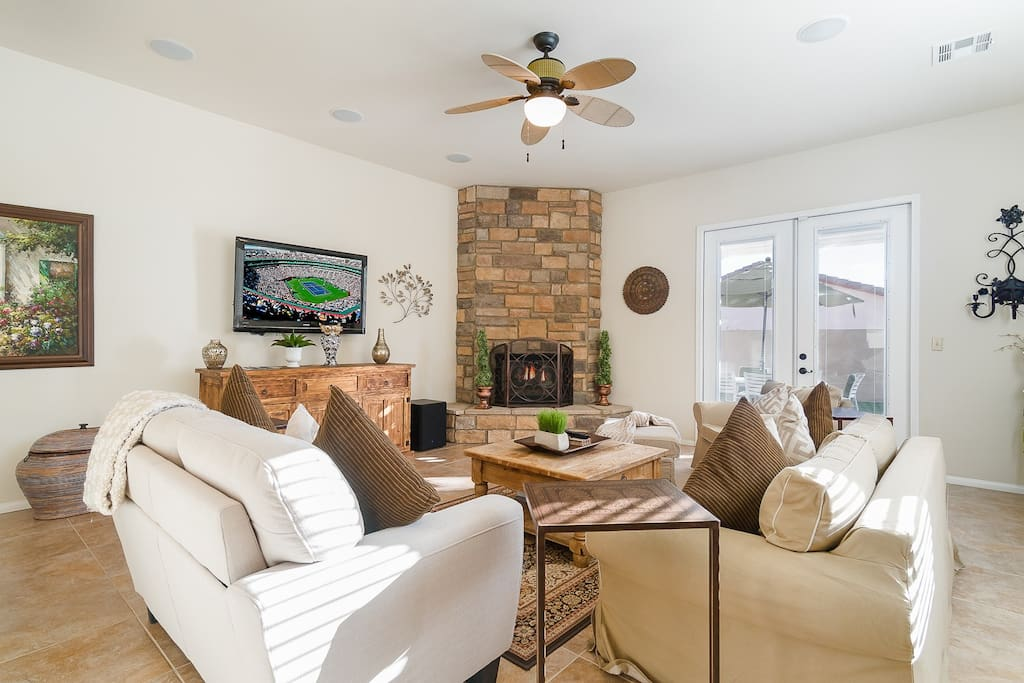 "Enjoy a movie on the 50"" flat screen TV or sit by the stone fireplace in the comfy living room."