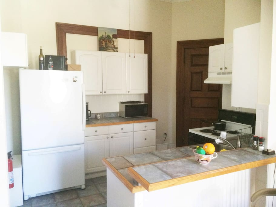 CLEAN kitchen with access to Frig/Freezer, Stove Top, Oven, Sink, Garbage Disposal, Plenty of Counter Space, Microwave, and toaster.  Apartment is fully equipped with utensils, pots and pans :)