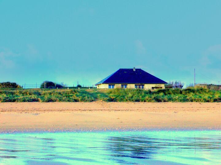 maison vue mer - les pieds dans l'eau