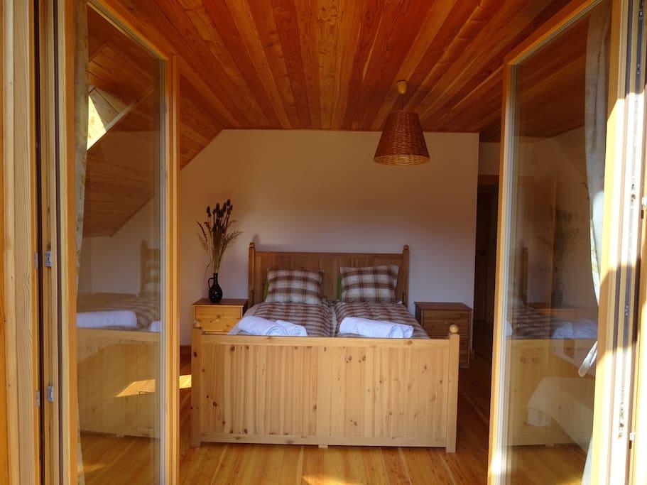 One of the bedrooms - view from the balcony / Sypialnia widziana z balkonu.