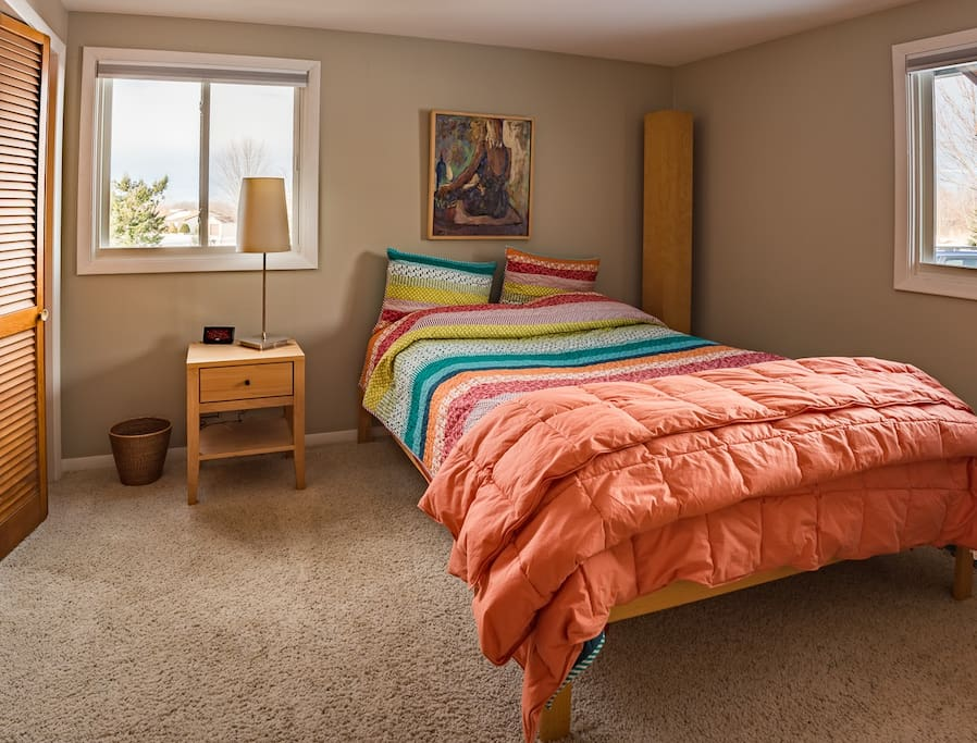 Secondary guest bedroom with queen-sized bed.