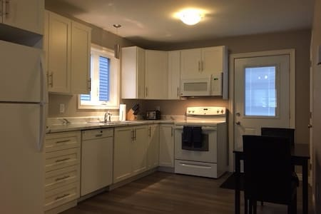 Full basement apartment in new house by airport