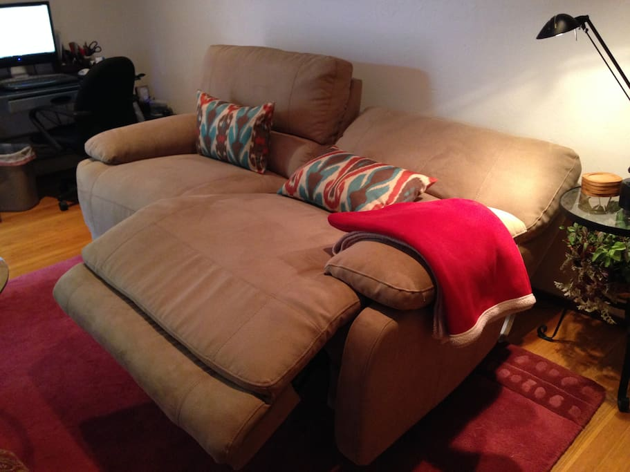Sofa electronically reclines. Can sit two or more people.