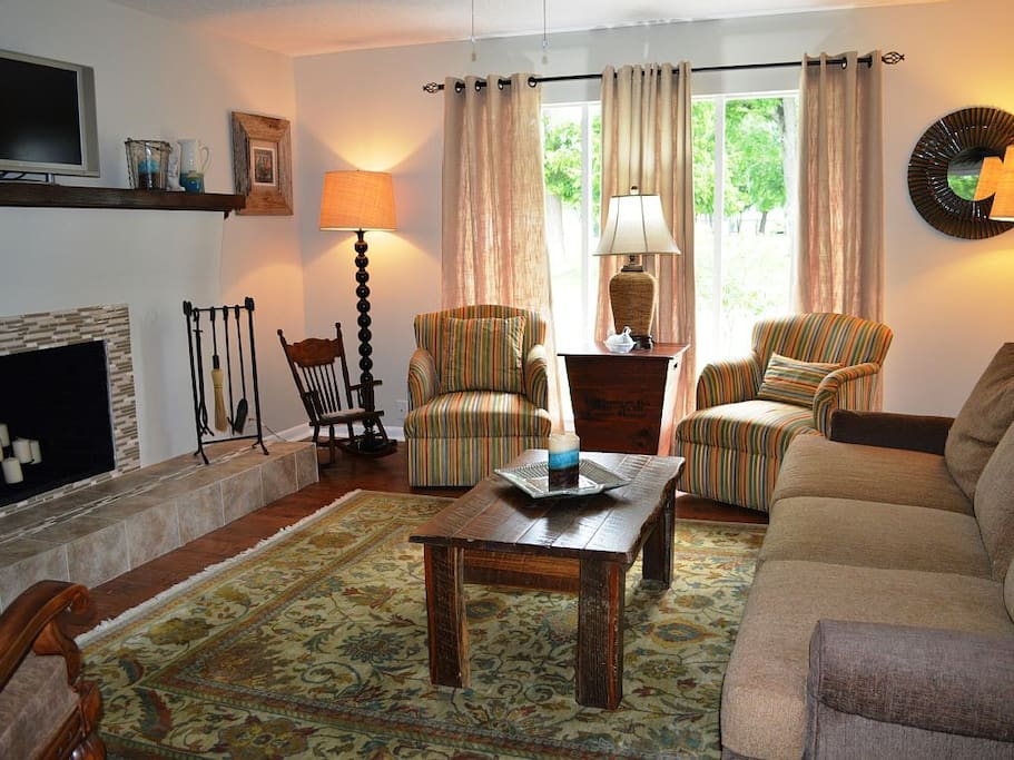 Cozy living room has games, cable TV, and plenty of seating for friends.