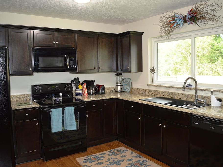 The renovated kitchen is filled with everything you need to whip up a meal.