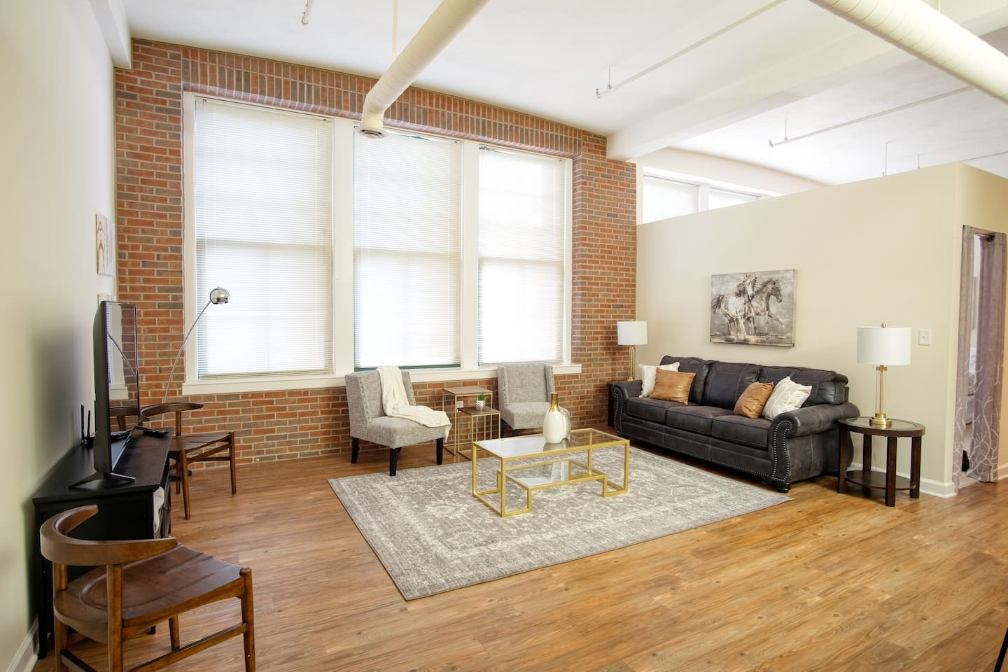 Relax in our spacious open concept space with classic ultra high ceilings, huge windows, and brick wall interior