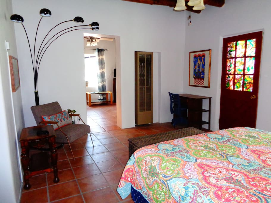 Bedroom has nice seating area and door opens to private patio.