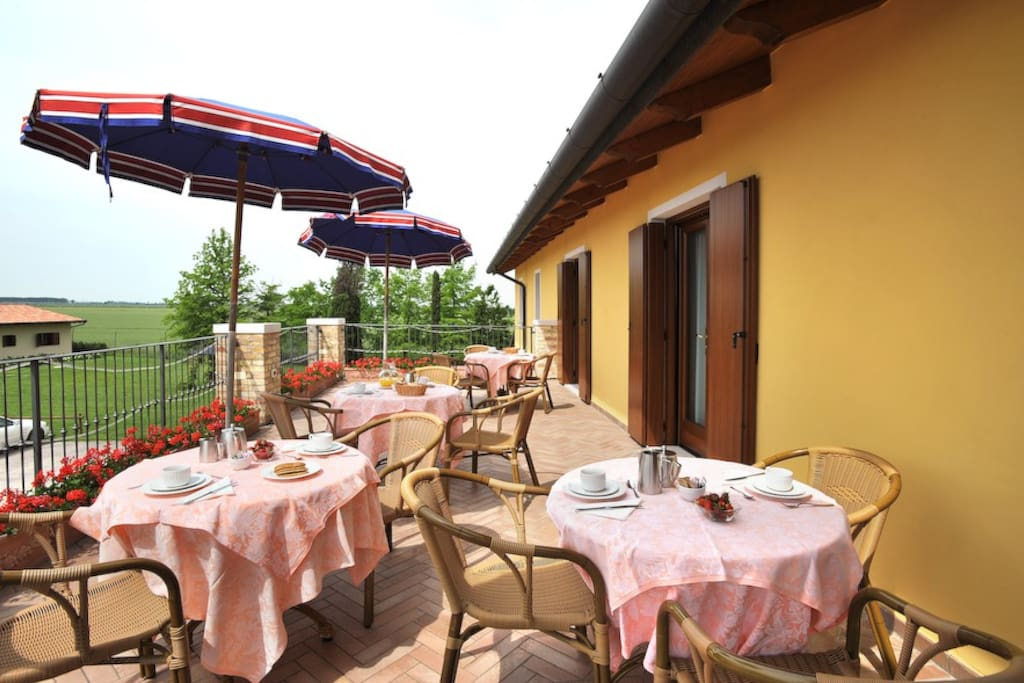 The breakfast terrace of the italian farmhouses with the wonderful view