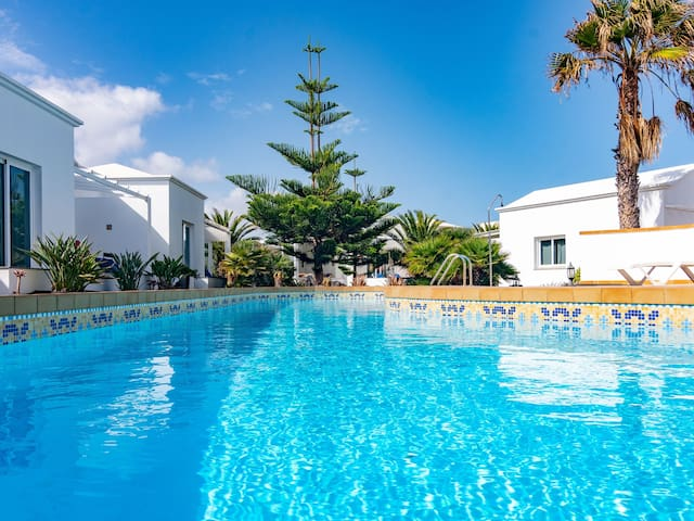 Two bedroom bungalow in Charco del Palo with communal pool.