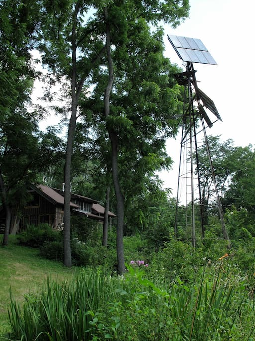 Here's our home, with the Tower of  Power (our solar panels mounted on an old windmill tower) in the foreground. Ida's Nest is upstairs.