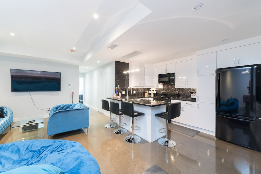 Open concept kitchen and living area [Unit 302]