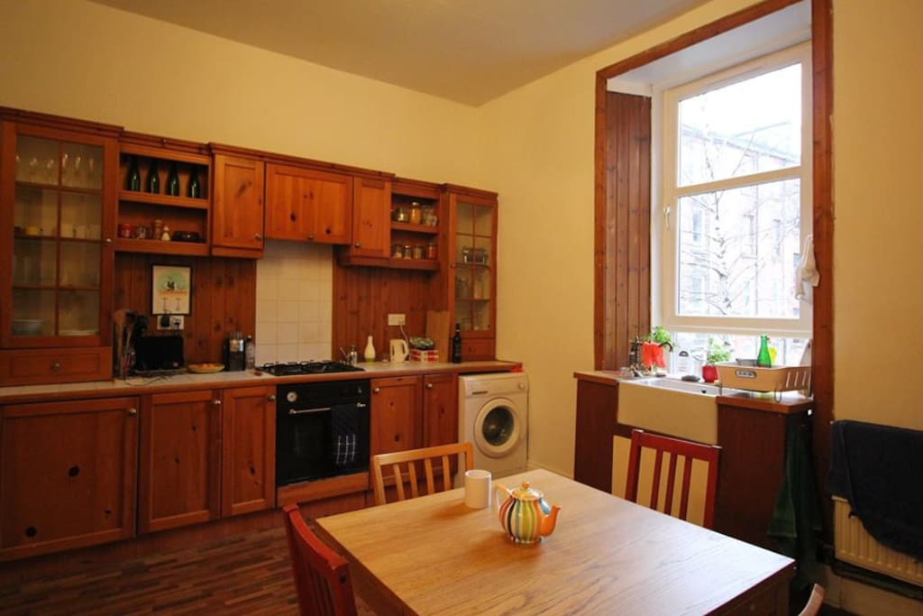 Your kitchen-dining room, with gas cooker, huge sink, loads of nice crockery, and an extender table that seats 8.