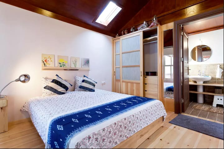 Master suite & terrace - restored wooden house