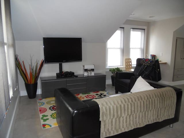 Living area with desk and television.