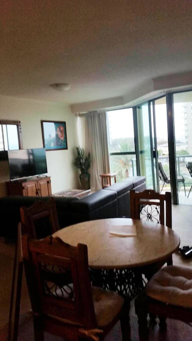 Living, Dining Areas and balcony nicely furnished