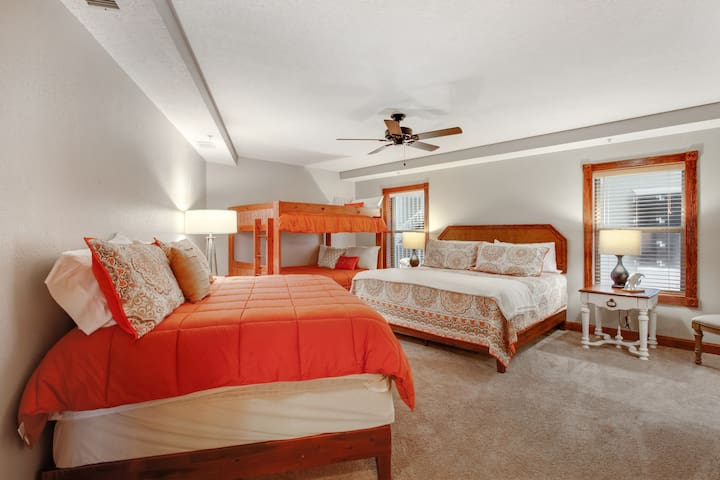 Can you say sleeping space?? This huge  second Master bedroom features a king bed, a queen bed and a set of full size bunk beds!