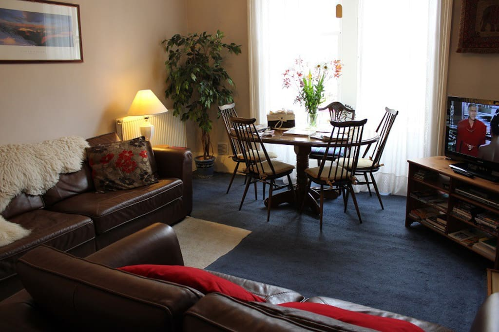 Spacious and homely lounge with large traditional sash windows, dining area and flat screen TV & DVD player.
