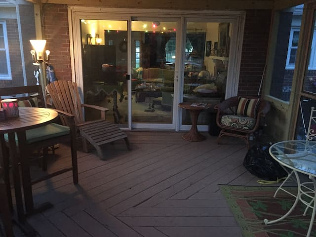 Back Porch with teak and wicker furniture plus a glass top table!