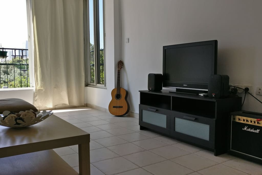 Large Smart TV, Guitars and a Sound System