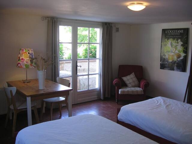 Room 3 - Coppernic.  A charming and spacious room that can be used as a twin or double.  It has an en-suite bathroom with tiled walk-in shower, wash basin and toilet. It has its own entrance overlooking the pool with direct access to the garden.