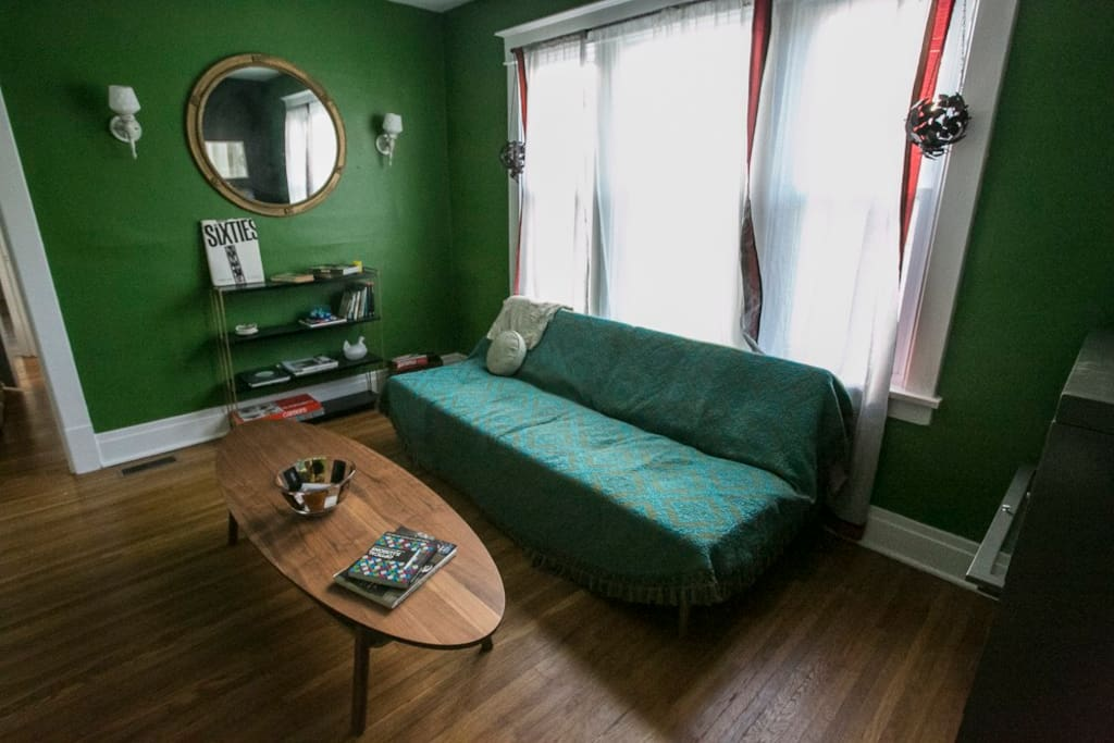Living Room - This couch flattens to bed #4