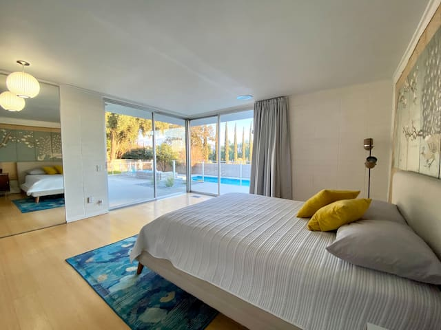 Master bedroom with sunrise views looking over the pool area .