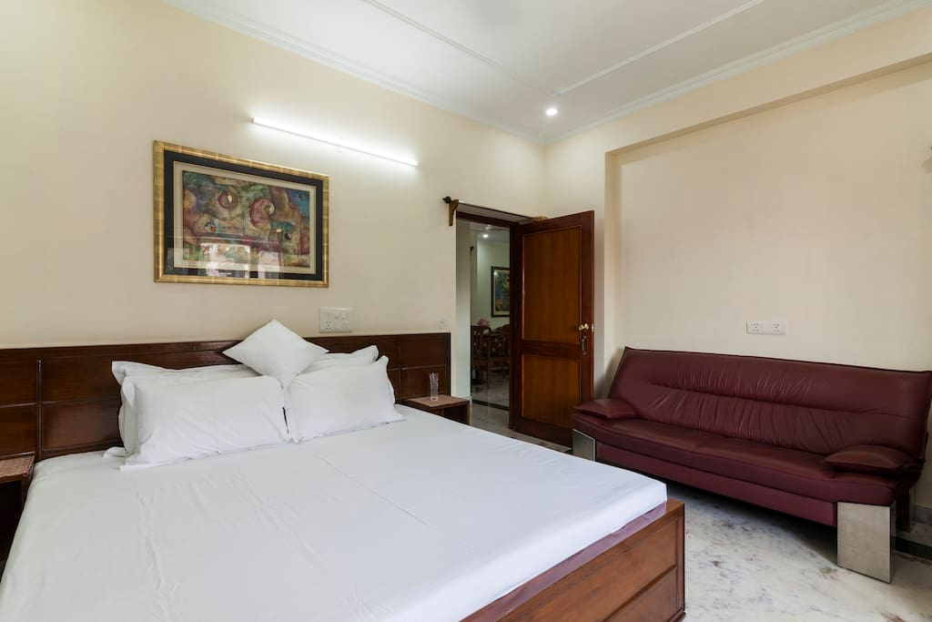 "The HOMESTAY  is a Suite accommodation and comes with Stanley genuine leather sofa within the ""Dream Rooms,"" the ultimate in luxury and comfort."