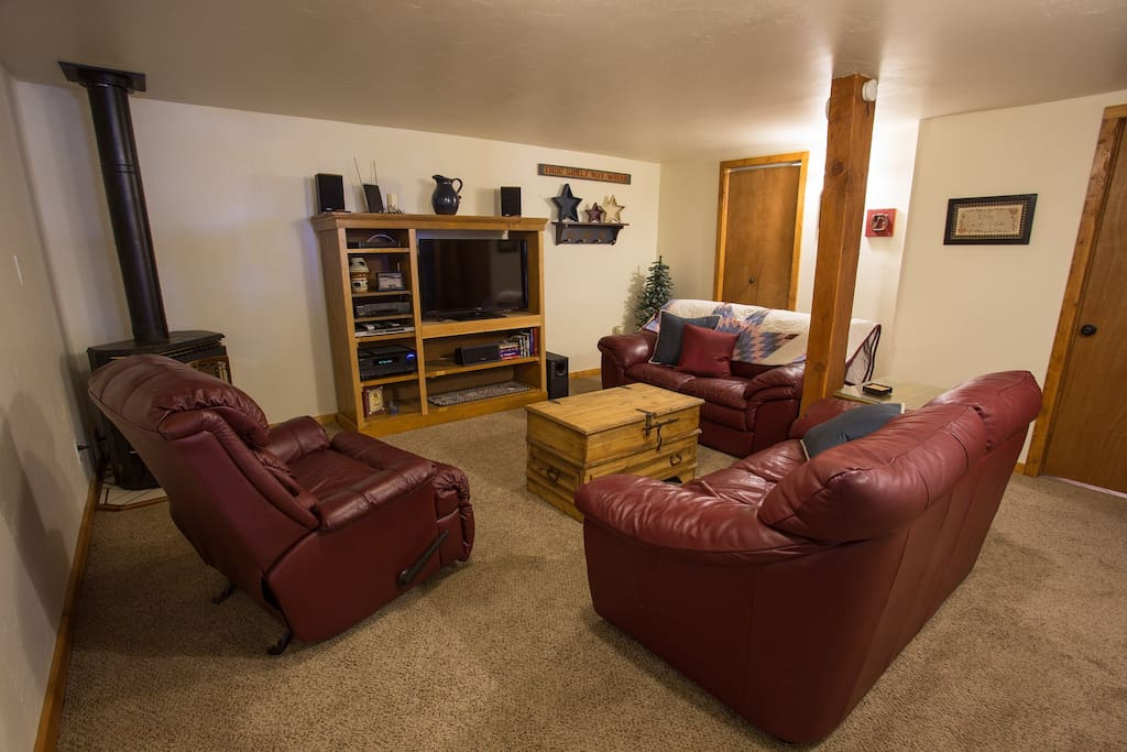 Cozy family room with gas stove, satellite TV and laundry room on far side.