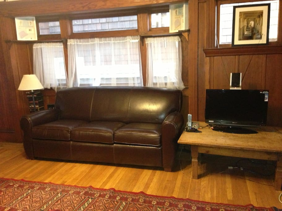 Living room has a leather, sleeper couch which folds out to a double bed.