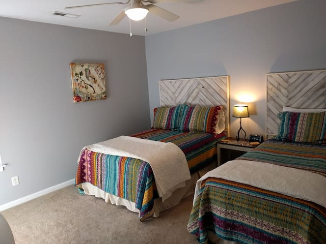 White room, a full and twin bed, we made the headboards.