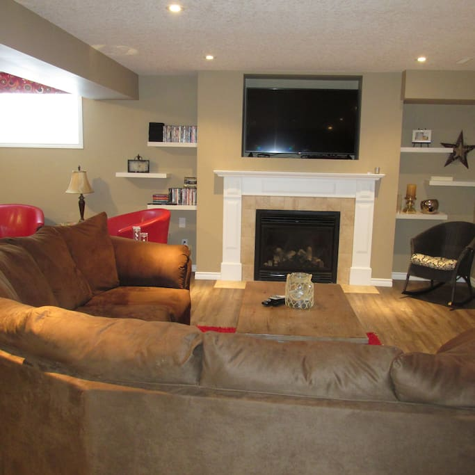 """Rec room with 55"""" TV, kitchenette, pool table and elliptical"""