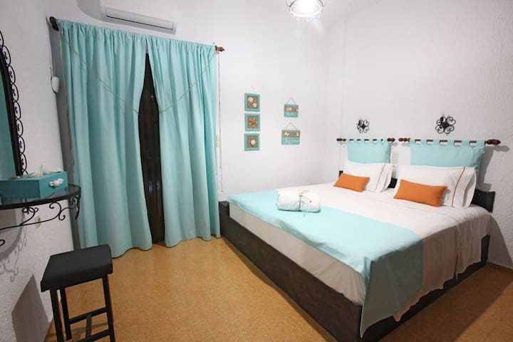 Bedroom with a double bed, aircondition and big wardrobe.