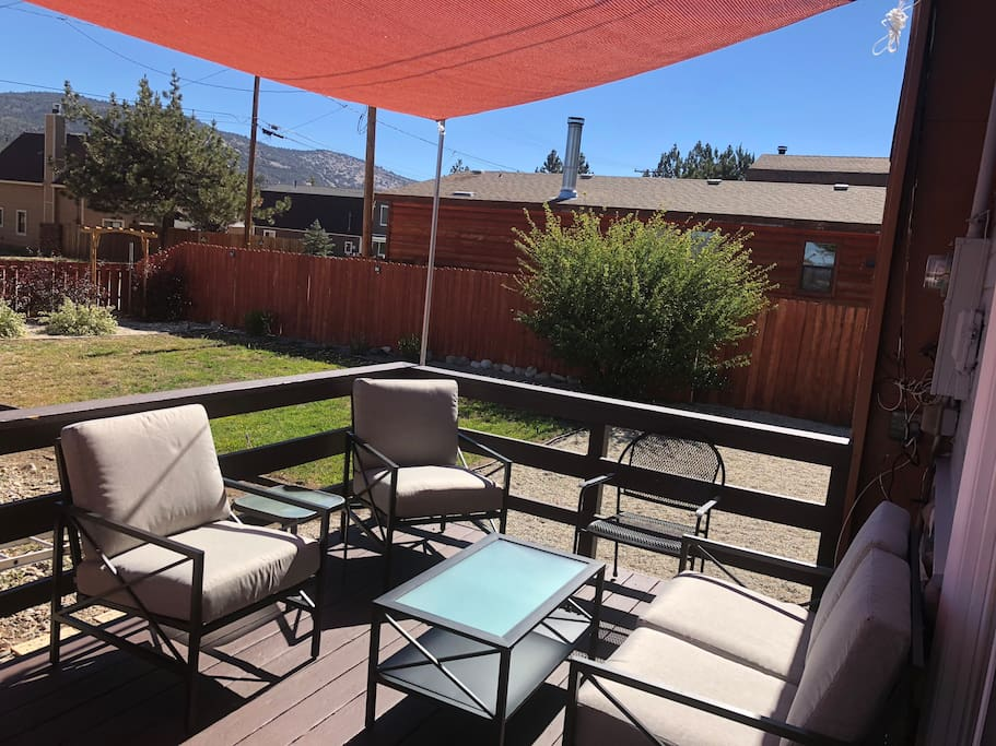 Outdoor seating on the porch with canopy shade for casual dining with a Mountain View!