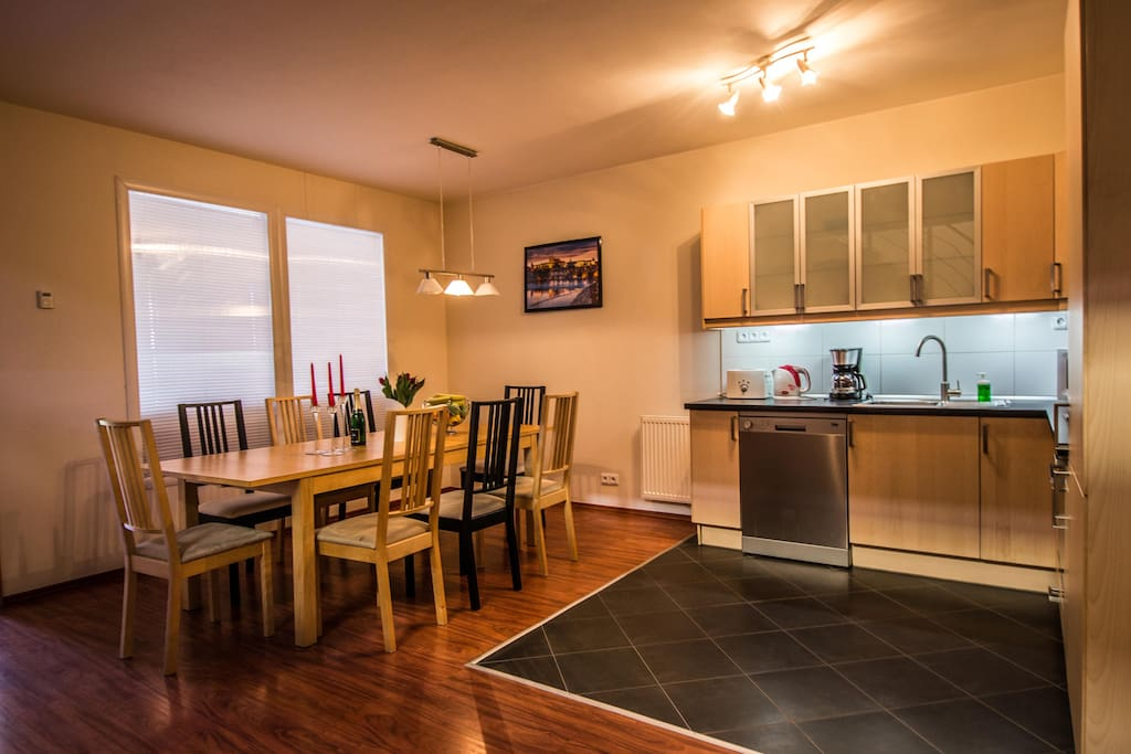 Spacious dining room with big table connected to the kitchen, where you will find everything for your comfortable stay: stove, oven, microwave, dishwasher, kettle, toaster, coffemaker and cooking basics.