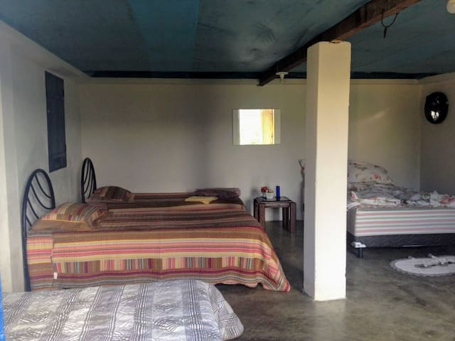 The dormitory accommodates 6 persons with 2 double and 2 singel beds as showed in this view.