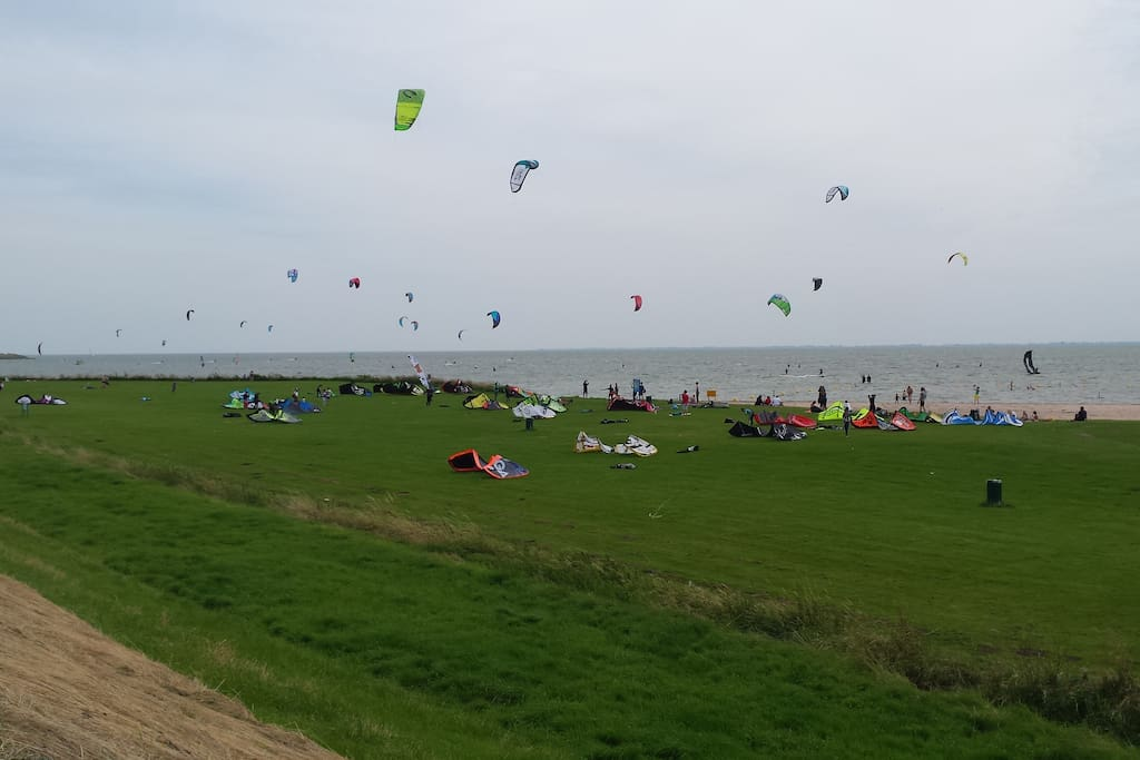 Kite and wind surfing, toddlers beach, at 1 km
