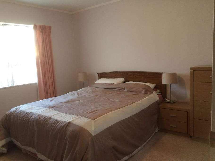 Restful master bedroom with large double built in wardrobe