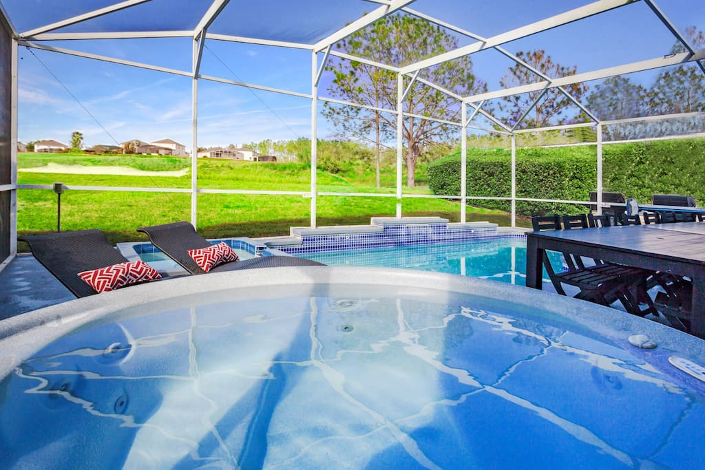 Patio by Poolside with BBQ grill, hot tub spa & seating for 28