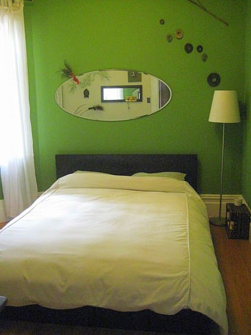 Your room - a verdent green oasis with comfy queen bed and even comfier big thick duvet!