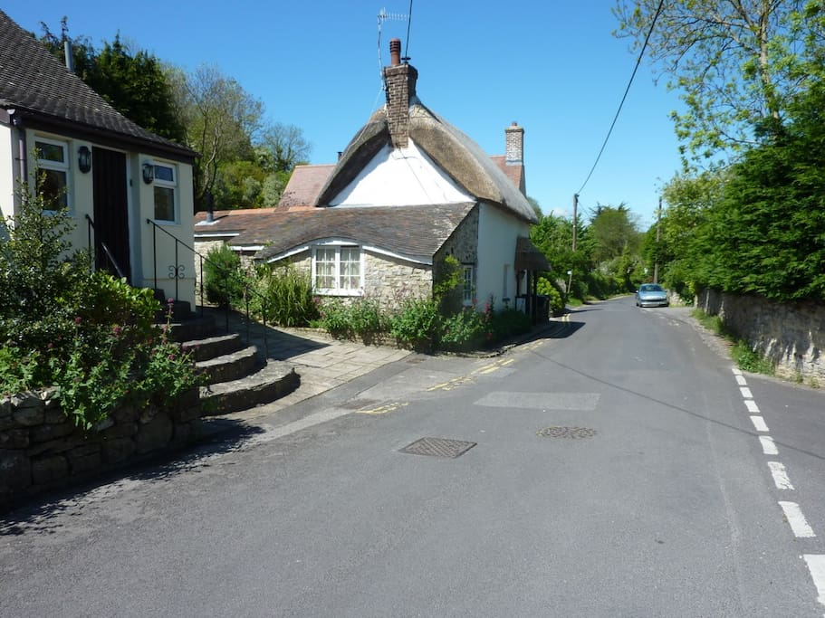 View down School Lane towards the 16th century, thatched pub at the end of the road