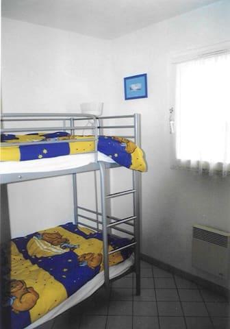 Chambre avec lit superposé