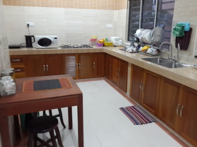 Kitchen with cooking facilities, microwave, facilities