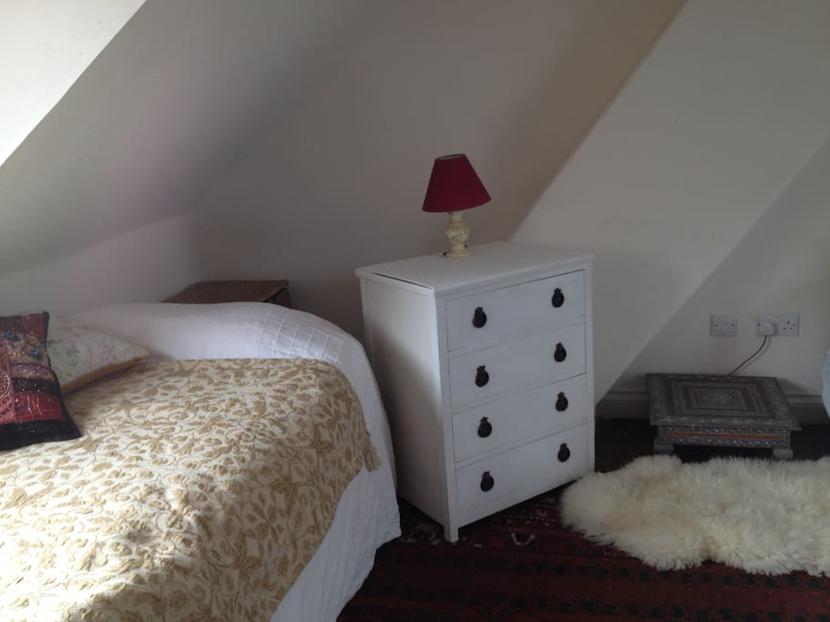 This is one corner of the room available which also has a double bed.