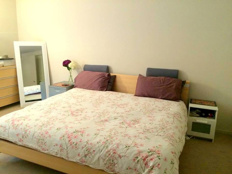 Large and comfortable master bedroom with a super-king bed with high quality linen and a full length mirror