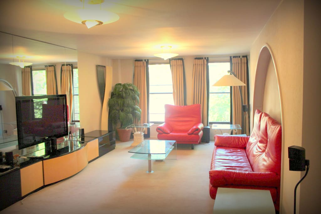 Large living & dinning room with surround sound speaker system, music player and large LED TV